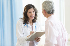 Doctor Discussing With Patient In Hospital Stock Image
