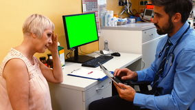 Doctor discussing with patient over digital tablet stock video