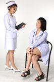 Doctor discussing prognosis with nurse Royalty Free Stock Image