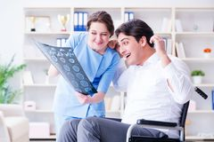 The doctor discussing x-ray image with patient Stock Photos
