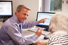 Doctor Discussing Test Results With Senior Female Patient Royalty Free Stock Images