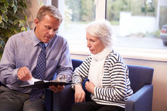 Doctor Discussing Test Results With Senior Female Patient Stock Image