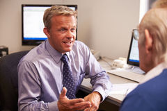 Doctor Discussing Test Results With Senior Male Patient Stock Photos