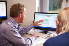 Doctor Discussing Test Results With Senior Male Patient Royalty Free Stock Photos