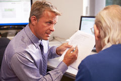 Doctor Discussing Test Results With Senior Male Patient Stock Photography