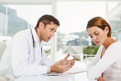 Doctor in discussion with patient in medical office Stock Photography