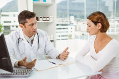 Doctor in discussion with patient in medical office Stock Images