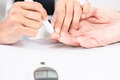 Doctor do blood sugar test royalty free stock image