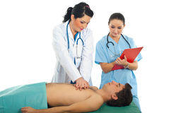 Doctor do cardiopulmonary resuscitation. Doctor training a student to do cardiopulmonary resuscitation on male patient royalty free stock photos
