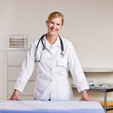 Doctor in doctor office Stock Images