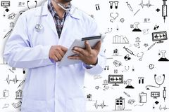 Doctor. Is using tablet and icon stock photo