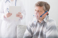 Doctor does inhalation  man Royalty Free Stock Photos