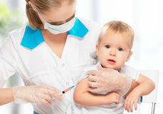 Doctor does injection child vaccination baby Royalty Free Stock Images