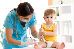 Doctor does injection child vaccination baby Royalty Free Stock Photography