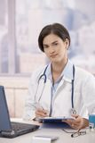 Doctor doing administration in office Royalty Free Stock Images