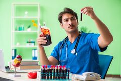 The doctor doing blood analysis in the lab. Doctor doing blood analysis in the lab Stock Photo