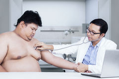 Doctor doing checkup on his patient Stock Photo