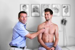 Doctor Doing A Examination Royalty Free Stock Images