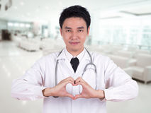 Doctor doing a heart with his hands Royalty Free Stock Image