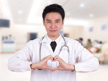 Doctor doing a heart with his hands Royalty Free Stock Photos