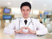 Doctor doing a heart with his hands Stock Photography