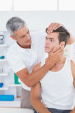 Doctor doing neck adjustment Stock Photo