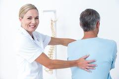 Doctor doing neck adjustment Royalty Free Stock Photo