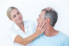 Doctor doing neck adjustment Stock Photos