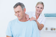 Doctor doing neck adjustment Royalty Free Stock Image