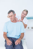 Doctor doing neck adjustment Royalty Free Stock Photo