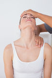 Doctor doing neck adjustment Royalty Free Stock Photography