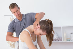 Doctor doing neck adjustment Stock Image
