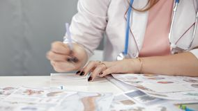 Doctor doing paperwork in her office.Portrait of nurse writing prescription.  stock video footage