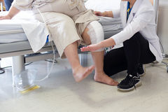 Doctor doing Physical therapy for Patient with a knee injury. In hospital Stock Images