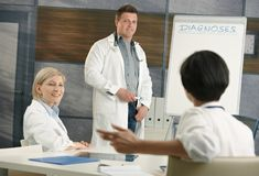 Doctor doing presentation for colleagues Stock Photo
