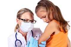Doctor doing vaccine injection to child Royalty Free Stock Photography