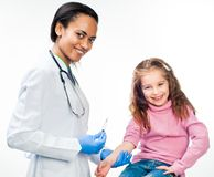 Doctor doing vaccine injection to a child Royalty Free Stock Photo