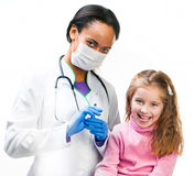 Doctor doing vaccine injection to a child Royalty Free Stock Image