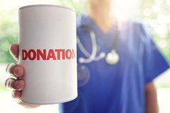 Doctor with donation box. Doctor holding a donation box Royalty Free Stock Photos