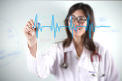 Doctor draw beat. Female doctor drawing heart beat graphic royalty free stock photography