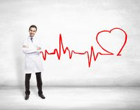 Doctor and drawing cardiogram Royalty Free Stock Photo