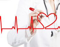 Doctor drawing a heart beat ECG. Doctor drawing heart beats stock photography