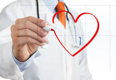 Doctor drawing heart symbol Royalty Free Stock Images