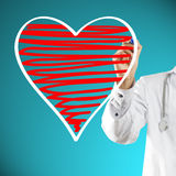 Doctor drawing heart symbol Royalty Free Stock Photography