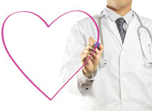 Doctor drawing a heart symbol Royalty Free Stock Images