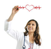 Doctor drawing a heartbeat. Asian Indian female doctor drawing a heartbeat over white background. Medical concept Royalty Free Stock Photo