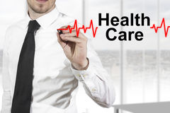 Doctor drawing heartbeat line health care Royalty Free Stock Image