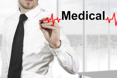 Doctor drawing heartbeat line medical Stock Photo