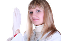 Doctor dress gloves. Young doctor dress gloves isolated royalty free stock photos