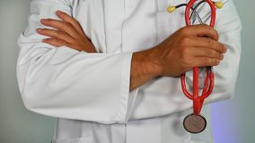 Doctor dressed in white coat. stock photo